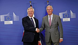 UK and EU chief negotiators David Davis and Michel Barnier shake hands