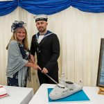 HMS Forth commanding officer Commander Robert Laverty's wife Lisa, with Able Seaman Jamie Philpot, cutting the cake.