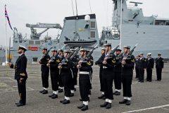 Lt Samuel Kerridge RN presenting arms.