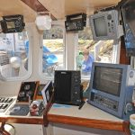 Other than the coffee mug, I've never seen a cleaner wheelhouse! Note the video screens for the engine compartment and fish hold cameras, and the TFT screen on the right, soon to be connected to an Olex system.