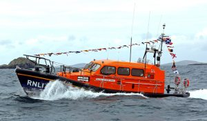 The 13m Shannon lifeboat Stella and Humfrey Berkeley approaches Leverburgh for the first time