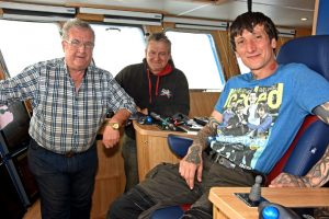 John McAlister with skippers Ian Fletcher and Iain McAlister.