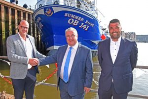 Leon Padmos of Padmos congratulates John McAlister after the naming ceremony of Summer Rose, watched by chief engineer Daniel Vlietland.