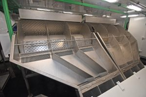 A KM MK II gutting machine is incorporated into the fish-handling system.