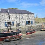 With a combined age of over 220 years, the 45ft Isabella Fortuna and the 20ft Rose Leaf wait for the tide to come into Portsoy's old inner harbour, alongside the rebuilt grain store.