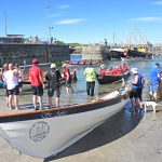 St Ayles skiffs being readied for the first races on the second day of the festival.