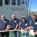 Malvin Grenstad, Kåre Jarl Landgeland, skipper Grie Skare and Ola Martin Grotle wait for the flood tide, before leaving Macduff harbour to head west along the Moray coast to Portsoy.