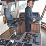 Engineer Andrew Lemon shooting away the wires at the trawl console.