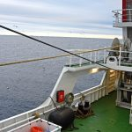 Using the tailend winch positioned above the port split trawl winch…
