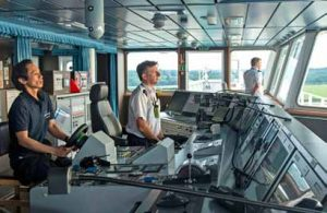ABP pilots Chris Hoyle and Neil Dunn focus on navigating CMA CGM Antoine de Saint Exupery and passing instructions to the ship's helmsman.