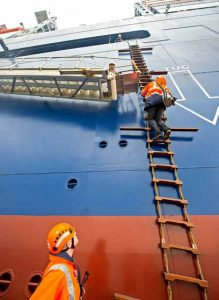 ABP pilot Chris Hoyle climbing one of the 19 steps to board CMA CGM Antoine de Saint Exupery, while second coxswain Matt Stubbs keeps a watchful eye.