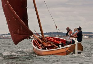 ree Spirit, one of two cobles built at Bridlington in 2014, sailing hard in North Bay.