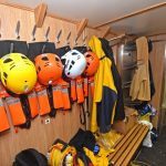 PPE gear and deck clothing are stored in the port passageway.