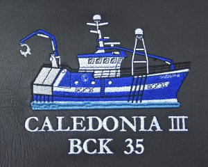 Profiles of Caledonia III are embroidered on the headrests of the NorSap skipper's seats.