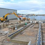 Construction work in progress to new side-slipping facilities between the recently strengthened main slipway at Buckie and the adjacent repair hall.