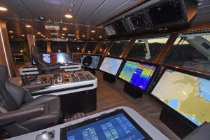 General view of the main wheelhouse consoles and the Furuno video wall.