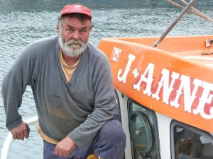Grimmy before the start of his 2004 voyage from Newlyn to the House of Commons aboard his 29ft trawler, J-Anne, which was decked with banners to protest against the dumping of fish.