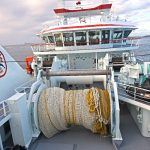 Midwater trawling activities are carried out aft on the full-length boat deck.