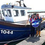 Tommy Russell, chairman of Poole and District Fishermen's Association, with Emma Rance of Dorset Wildlife Trust, after completing the Seafish RFS process.