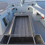 The fish seawater separator on the boat deck amidships is enclosed on three sides...