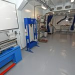 The large and well-equipped engineering workshop includes an enclosed and extracted welding bay.