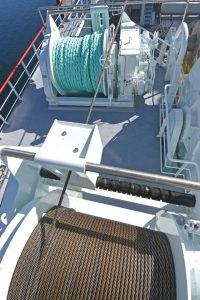 The lifeline winch is mounted on the upper boat deck, aft of the starboard trawl winch.