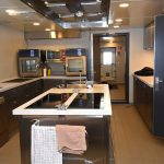 ... and galley, with a double induction hob and deep-fat fryer, flush-mounted in an island unit.