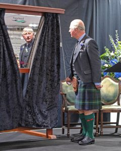 HRH Prince Charles unveils the commemorative plaque to officially open the new Peterhead whitefish market.