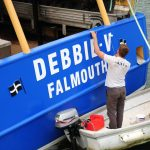11. Skipper Tom Beresford putting the finishing touches to the paintwork.