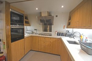The well-equipped modern galley is arranged on the port side of the transom…