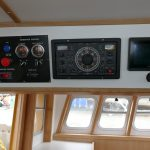15. Various read-outs, autopilot and engine control panels are overhead to port of the skipper's seat.