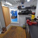 A workshop in the forward starboard corner of the deck casing leads onto the main deck.