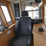 18. The skipper's seat to starboard, with controls on either side.