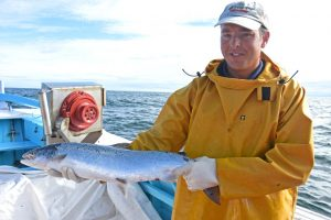 Pride in their work – Shaun holds a superbly conditioned salmon.