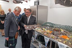 Scottish Seafood business manager Jimmy Buchan welcomes Prince Charles to the new market's training room...