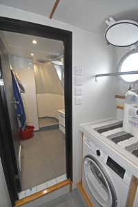A large shower and washroom compartment is arranged on the aft port quarter of the deck casing, adjacent to laundry facilities.