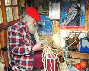 Des Pawson does knots – which, here in his workshop, make a boat fender...