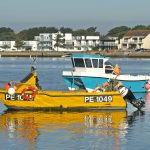 3. Fishing boats moored at Mudeford, at the entrance to Christchurch harbour. Tim Edgell's Edge On PE 1049 was the first yellow Cheetah catamaran built. The new blue-hulled 6m Cougar catamaran is currently being fitted out by Andy Griggs, before being registered.
