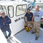 25. Peter's salvaged Cheetah catamaran Déjà Vu SU 21 is being rebuilt at Elkins Boatyard in Christchurch, including the fitting of a new wheelhouse under the guidance of the MCA. Peter Dadds monitors progress and inspects the new windows with Rich Walsh and his friend Colin.