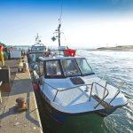 6. Taking pot bait onboard the Cheetah Marine catamaran Chloe and Christie PE 18 at Mudeford Quay.