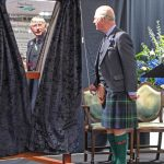 HRH Prince Charles, Duke of Rothesay, unveils the commemorative plaque to officially open the new Peterhead whitefish market.