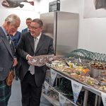 Scottish Seafood business manager Jimmy Buchan welcomes Prince Charles to the training room in the new market building…