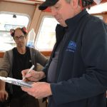 Seafish vessel surveyor Henry Millington at work, during the sea trials of the Joyful Spirit.