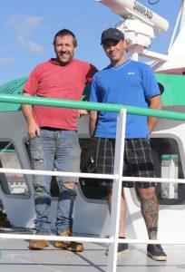 Skipper Scott Govier (left) with mate/crewman Scott Brehaut, after the maiden trip on Joyful Spirit last month.