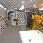 34 John Deere emergency genset and electrical cabinets in the 'tween space below the wheelhouse.