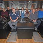 06 Research skippers and crew in the wheelhouse. Left to right: Harry Sandison Jr, Magnus Sandison, Harry Sandison Sr, David Nicolson, David Williamson, Gary Williamson, Alex Wishart, Nigel Tulloch, Michael Williamson, John Philip Sandison, Richard Williamson, Alex Fullerton, Bobby Williamson, Alex John Polson and Stuart Williamson.