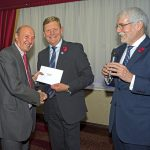Commodore David Dickens, chief executive of the Fishermen's Mission, presenting the second prize in the raffle to Tim Oliver. (Photo: Paul Riddell)