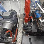 … through two Kawasaki load-sensing hydraulic pumps.