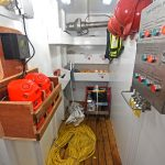 A general-purpose storeroom is situated in the forward port corner of the deckhouse…
