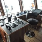 The wheelhouse trawl console provides a commanding view of fishing activities at the stern of Western Chieftain.
